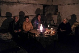 People sit in a bomb shelter during a military conflict in the city of Stepanakert, the breakaway region of Nagorno-Karabakh in Azerbaijan on October 5, 2020 [Areg Balayan/ArmGov PAN Photo via AP]