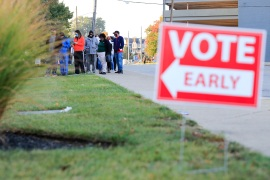 In many states, lines have been common when early voting begins [Aaron Doster/AP]