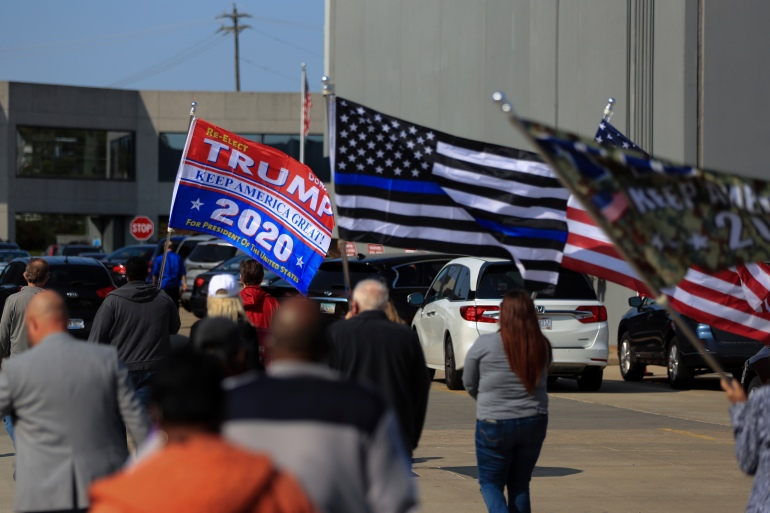 Democrats urge early, heavy turnout as Trump stokes voting fears