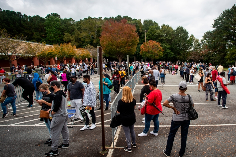 Hundreds of people wait in line for early voting on Monday, October 12 in Marietta, Georgia [Ron Harris/AP]
