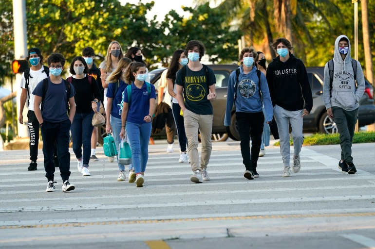 Public health experts have urged people across the United States to follow safety guidelines, such as mask-wearing, to prevent the spread of COVID-19 [File: Lynne Sladky/AP]