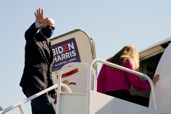Democratic presidential candidate Joe Biden boards his campaign plane en route to Durham, North Carolina [Carolyn Kaster/The Associated Press]