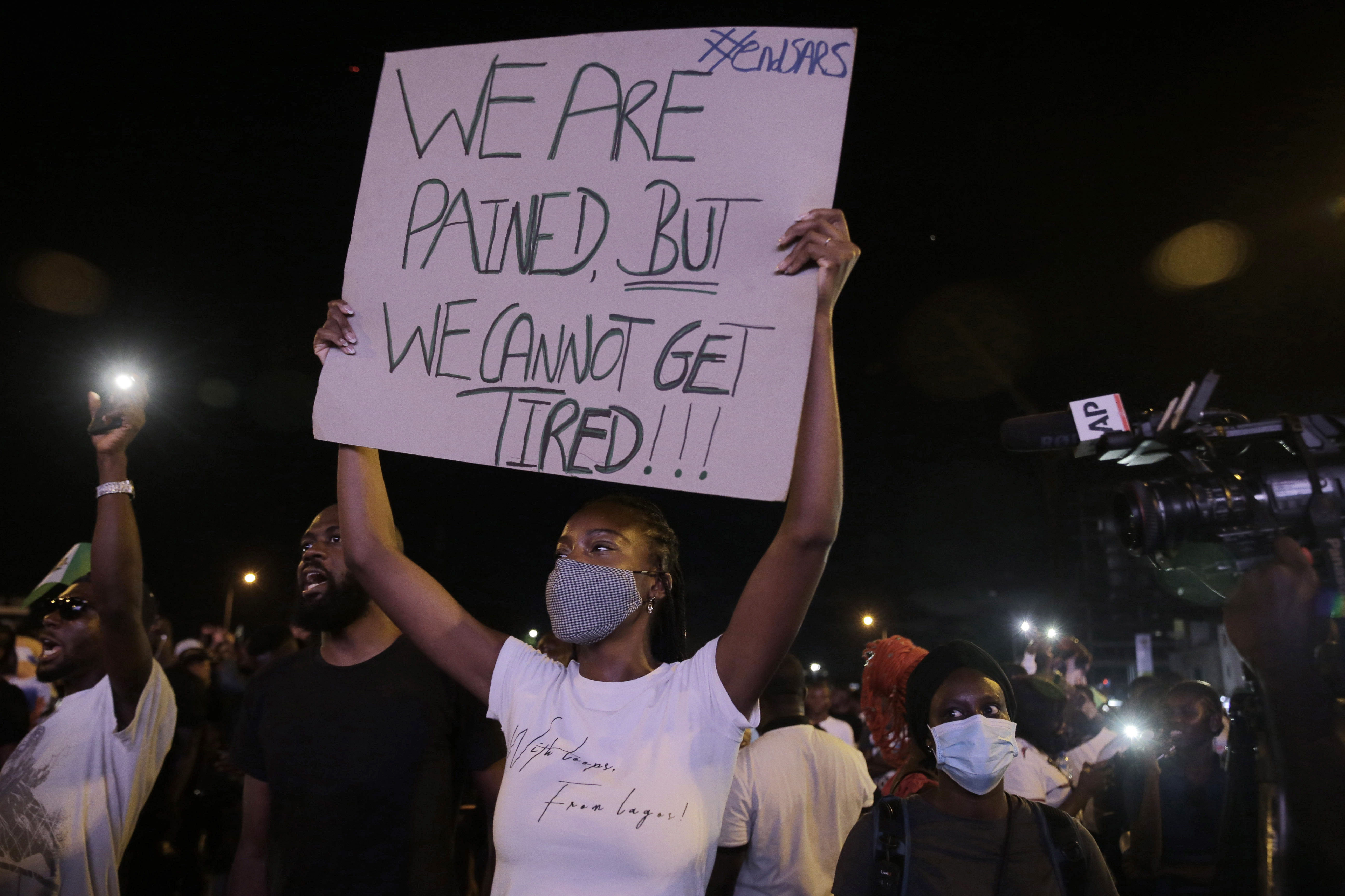 Nigerian soldiers fire at protesters, at least two hit
