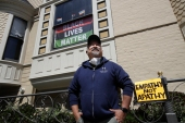 James Juanillo, a supporter of Black Lives Matter movement, poses outside of his home in San Francisco [File: Jeff Chiu/AP Photo]