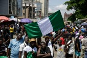Tens of thousands of people have been taking to the streets every day for nearly two weeks across Nigeria to demand an end to police violence [File: Sunday Alamba/AP Photo]