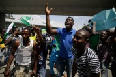 People demonstrate on the street to protest against police brutality, in Lagos, Nigeria [Sunday Alamba/AP]