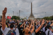 Pro-democracy activists flash three-fingered salute during a demonstration at Victory Monument in Bangkok, Thailand, October 21, 2020 [Sakchai Lalit/AP]