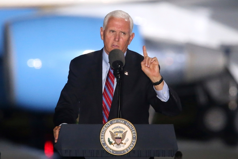 Vice President Mike Pence will continue to campaign, despite a close aide testing positive for coronavirus [Steve Cannon/AP Photo]