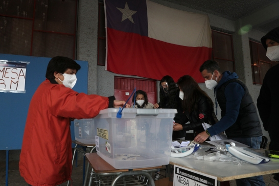 Chileans are voting on whether to draft a new constitution for their nation to replace guiding principles imposed four decades ago under a military dictatorship [Esteban Felix/AP Photo]