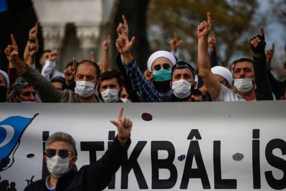 Demonstrators chant slogans during an anti-France protest in Istanbul, Sunday, Oct. 25, 2020 [Emrah Gurel/AP]