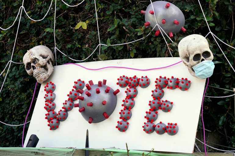 The coming Halloween holiday, the United States election and the coronavirus pandemic are combined in a 'VOTE' message outside a home in Los Angeles, California on October 26, 2020 [Chris Pizzello/AP Photo]