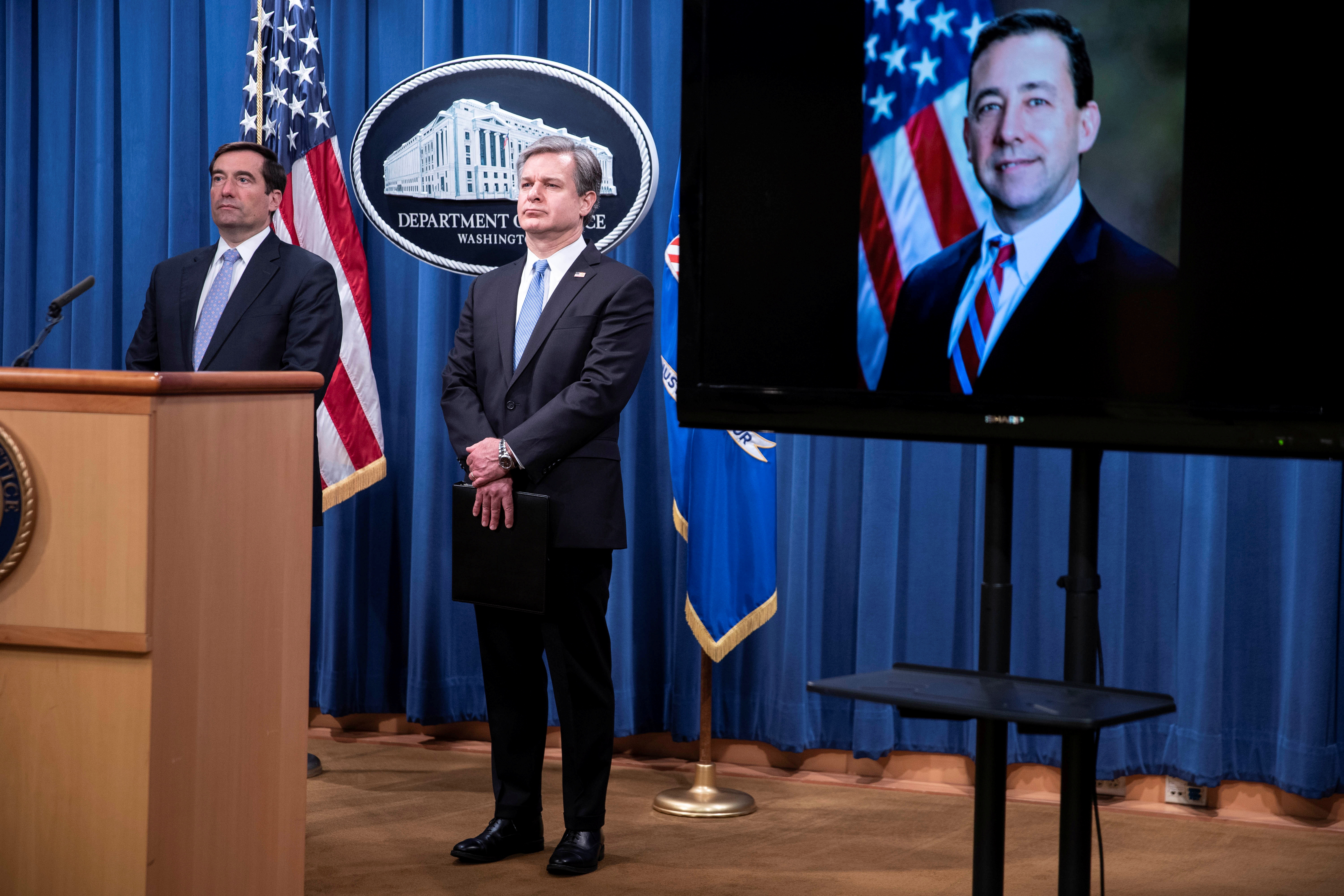 US Charges 8 Chinese Operatives in Intimidation Plot
