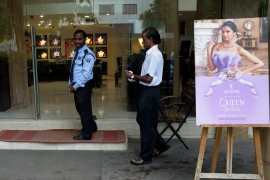 Security guards outside a jewellery shop displaying a Tanishq advertisement [File: Subhendu Sarkar/LightRocket via Getty Images]