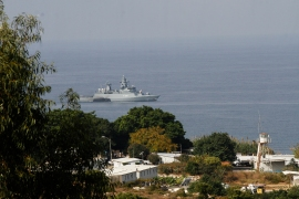 An Israeli navy warship is pictured from the southern Lebanese border town of Naqoura as it patrols the waters on Wednesday [Mahmoud Zayyat/AFP]