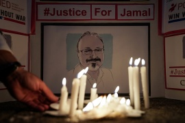A candlelight vigil in front of the Saudi Embassy in the US for murdered journalist Jamal Khashoggi [File: Reuters]