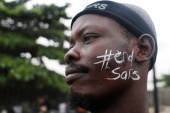 A demonstrator protests against Nigeria's Special Anti-Robbery Squad (SARS) in Lagos on October 17 [Temilade Adelaja/Reuters]