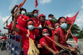 Supporters of the governing National League for Democracy (NLD) party take part in a campaign rally ahead of a November 8 general election, in the outskirts of Yangon, Myanmar, October 25, 2020 [Shwe Paw Mya Tin/Reuters]