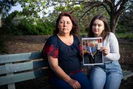 Rebecca (right) with her mother, Kelly, said that death of her grandfather from the coronavirus was avoidable [Ali MC/Al Jazeera]