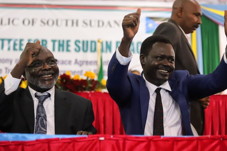Left, Dr Gibril Ibrahim Mohammed, leader of the Justice and Equality Movement (JEM) and Minni Arko Minnawi, right, leader of the Sudan Liberation Movement/Army (SLM/A), gesture after the peace agreement's signing on August 31, 2020 [Samir Bol/Reuters]