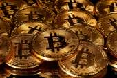 Crypto fans are closely watching bitcoin approach the $12,000 level, seen as as a major hurdle to cross before the currency can embark on a bigger rally [File: Dado Ruvic/Reuters]