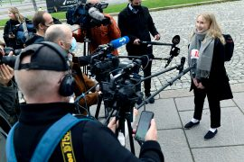 Aava Murto, a 16-year-old girl who has taken over the job of Finnish PM Sanna Marin for the day as part of a girls' rights campaign, is interviewed by members of the media in Helsinki, Finland [File: Lehtikuva/Heikki Saukkomaa/Reuters]