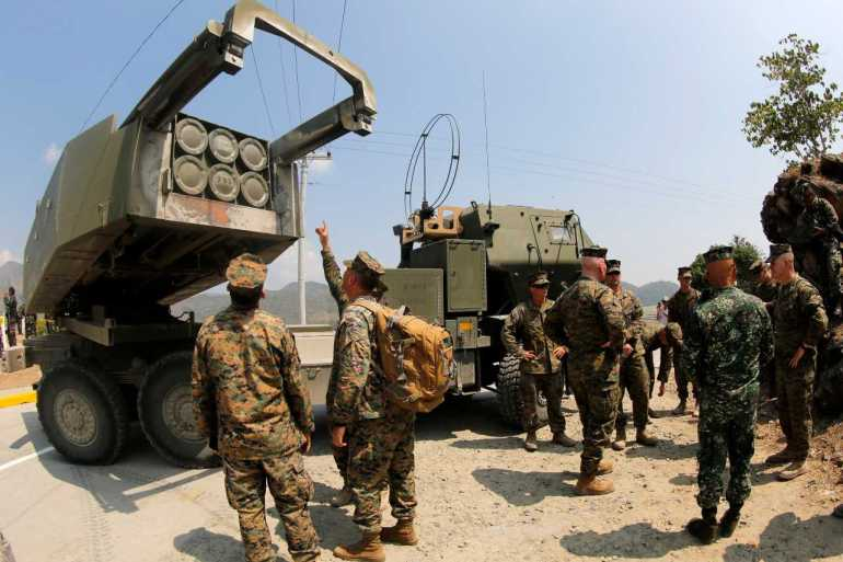 The truck-based rocket launcher, also known as High Mobility Artillery Rocket System (HIMARS), is made by the US arms dealer Lockheed Martin [File: Francis Malasig/EPA]