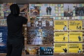 University of Hong Kong students rebuild a 'Lennon Wall' honouring the pro-democracy movement on their campus after it was destroyed by thugs [Jerome Favre/EPA]