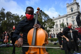 Freelance musicians from 'Let Music Live' pressure group perform in Parliament Square in London [Neil Hall/EPA]