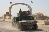 Afghan security forces patrol the Helmand-Kandahar highway [File: Watan Yar/EPA]