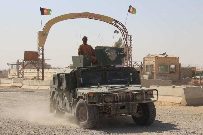 Afghan security forces patrol the Helmand-Kandahar highway [File: Watan Yar/EPA]