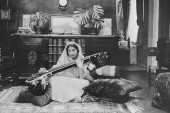 Noor Inayat Khan with a vina, a stringed Indian musical instrument [Courtesy of Shrabani Basu]