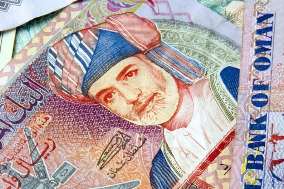 Oman, its rial currency pictured here, had already been downgraded twice this year by both Moody's Investors Service and Fitch Ratings [File: Charles Crowell/Bloomberg]
