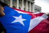 Proponents of Puerto Rico's statehood say it is the only way to give Puerto Ricans a voice, vote and equal footing in federal assistance programmes [File: Xavier Garcia/Bloomberg]