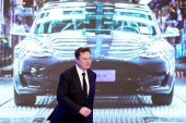 Tesla, whose market capitalisation at $394.5bn is the largest among all automakers in the world, has enjoyed a meteoric rise under Chief Executive Elon Musk [File: Aly Song/Reuters]