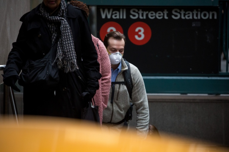 Dow drops 800 points as fears grow over fallout of COVID-19 surge