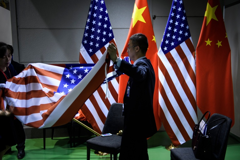Tensions in US-China ties will likely continue whether Trump or Biden wins [File: Brendan Smialowski/AFP]