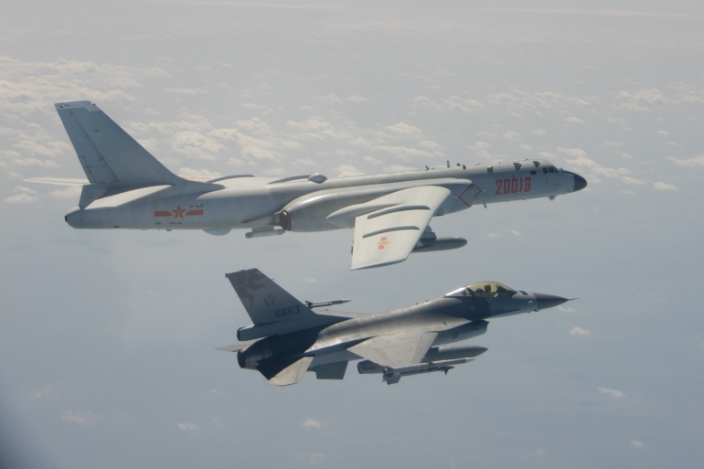 A Taiwanese F-16 fighter jet flying next to a Chinese H-6 bomber in Taiwan's airspace [File: Taiwan's Defence Ministry/AFP]