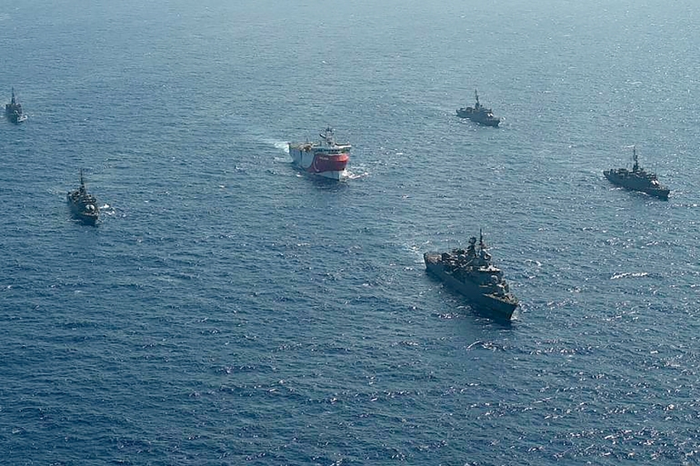 Tensions were stoked on August 10, when Ankara dispatched the research ship Oruc Reis, centre, accompanied by Turkish naval vessels off the Greek island of Kastellorizo in the Mediterranean [File: Turkish Defence Ministry/AFP]