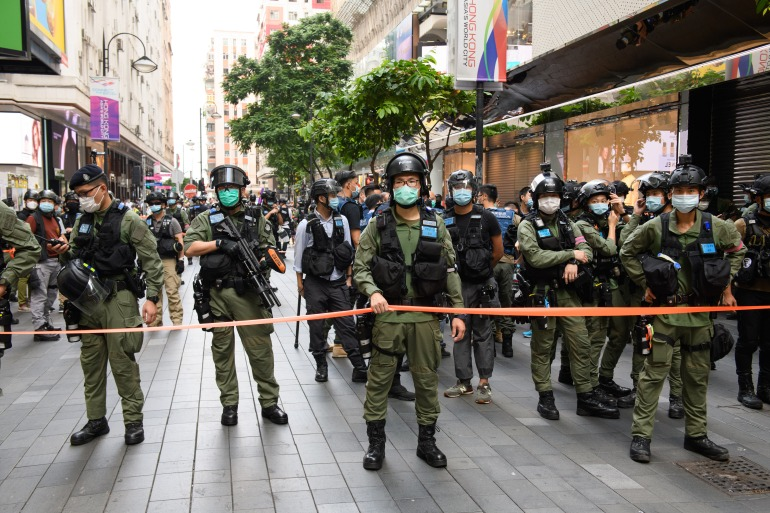 About two dozen people have been arrested under the new national security law China imposed in Hong Kong in June [Jayne Russell/ AFP]