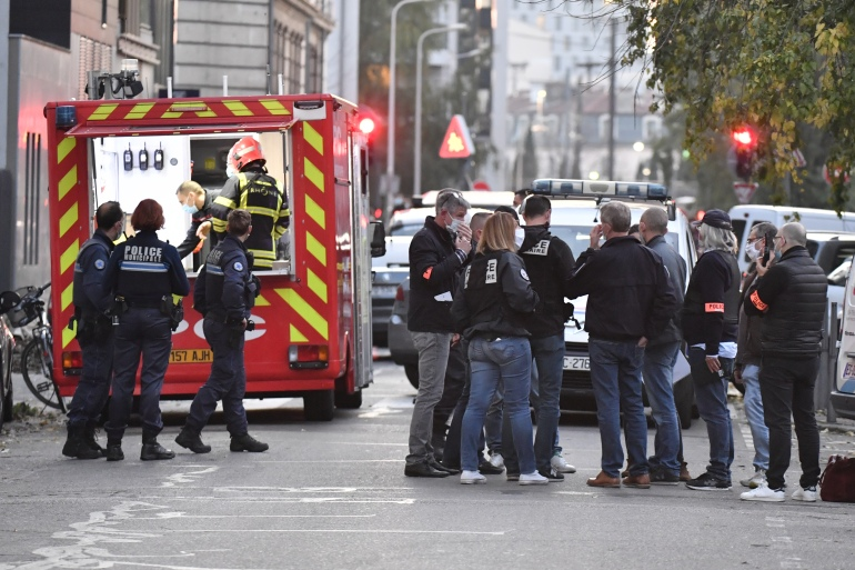 Security and emergency personnel in Lyon at the scene where an attacker armed with a sawn-off shotgun wounded an Orthodox priest [Philippe Desmazes/AFP]