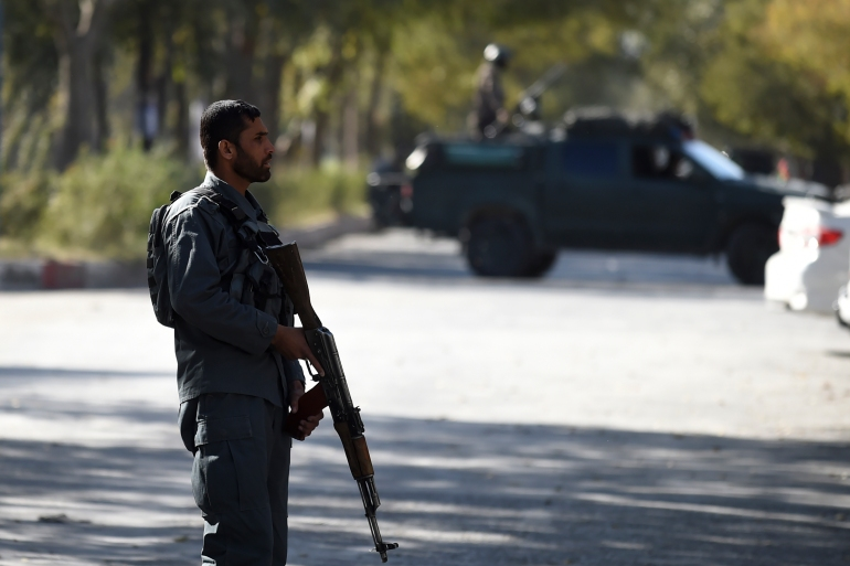 Afghan policemen keep watch near the site of an attack in Kabul [Wakil Kohsar/AFP]