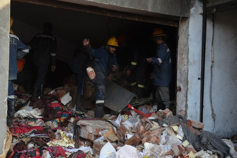 Witnesses say the huge explosion ripped apart the walls of the building [AFP]