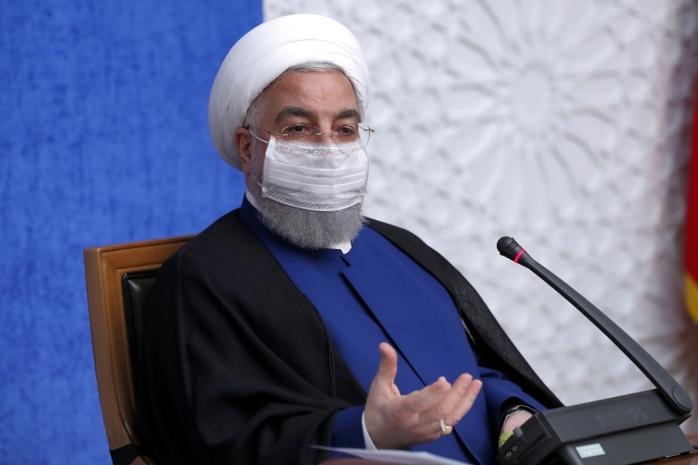 Iran President Hassan Rouhani urged Joe Biden to make amends for Donald Trump's Iran policy [Iranian Presidency via AFP]