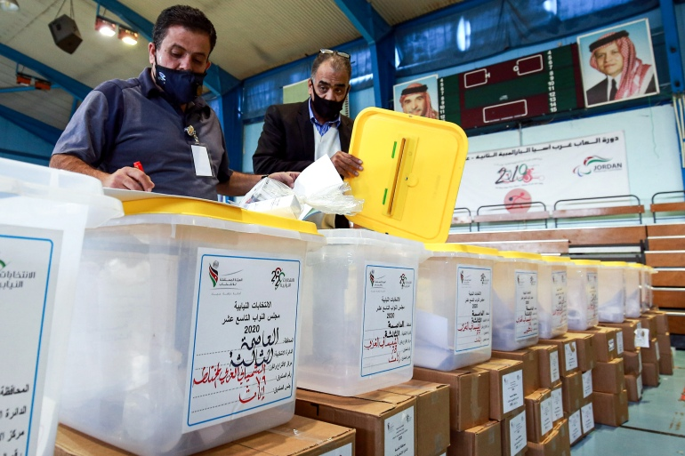Employees of Jordan's Independent Election Commission prepare ballot boxes at a polling centre in Jordan's capital, Amman [Khalil Mazraawi/AFP]