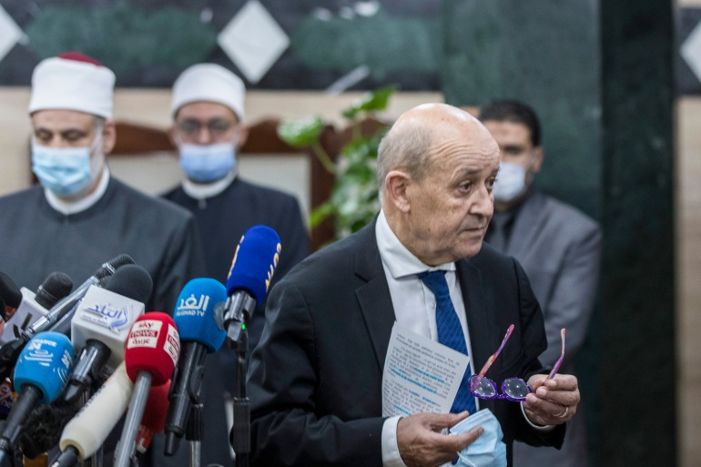 Sent to defuse tensions, Le Drian sought to convey an emollient message following the meeting [Khaled Desouki/AFP]