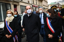 From left: President of French Ile-de-France region Valerie Pecresse, Paris Mayor Anne Hidalgo and Prime Minister Jean Castex walk in Rue Alibert to pay tribute to the victims of the attacks on November 13, 2020 in Paris [Christophe Archambault/Pool/AFP]