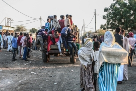Ethiopians fleeing intense fighting in their homeland of Tigray, gather in the neighbouring Sudanese Village 8, east of the town of Gadarif. [Ebrahim Hamid/AFP]