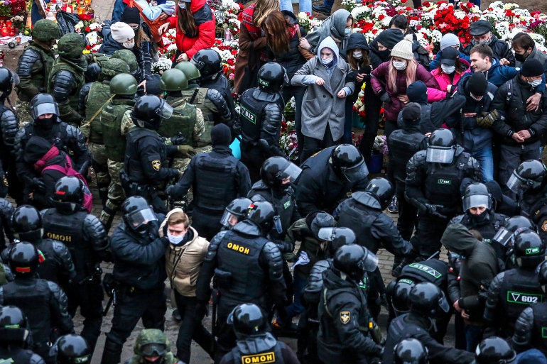 Law enforcement officers detain opposition supporters during a rally to protest against the Belarus presidential election results in Minsk [AFP]
