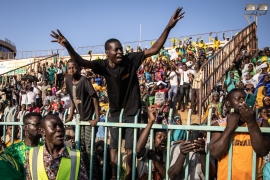 Supporters cheer Burkina Faso's presidential candidate Zephirin Diabre during a rally in Ouagadougou [Olympia de Maismont/AFP]