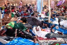 Ethiopian refugees who fled fighting in Tigray province lay in a hut at the Um Rakuba camp in Sudan's eastern Gedaref province [Ebrahim Hamid/AFP]